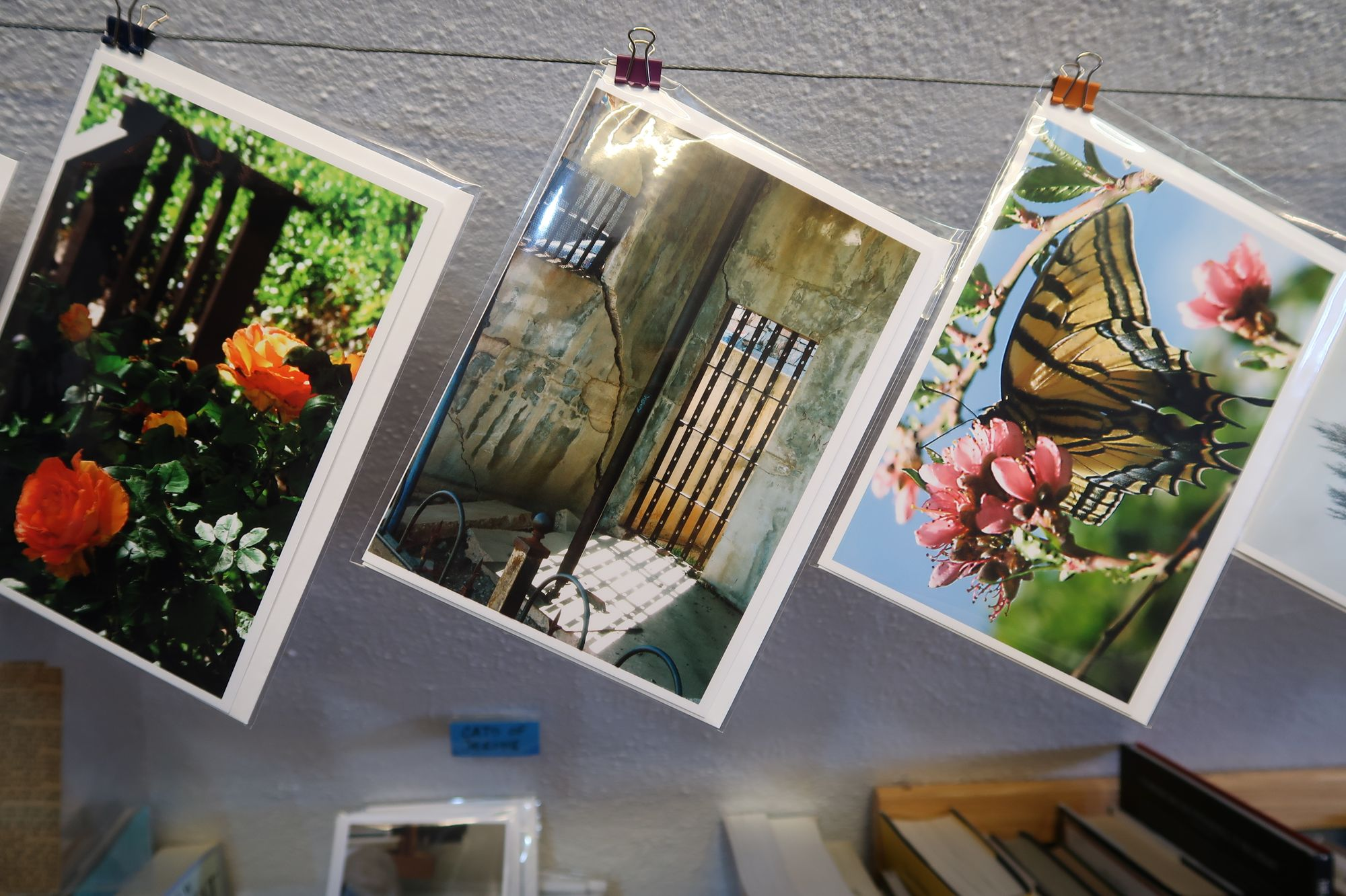 Photo of photos at Kate's Books showing the Sliding Jail at Jerome.