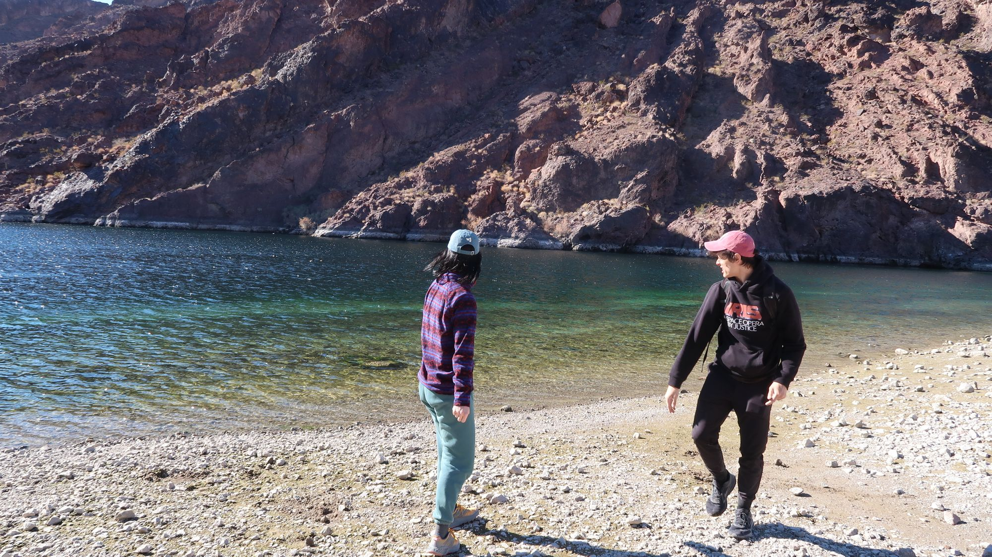 Ian and lacy skipping stones along the Colorado River