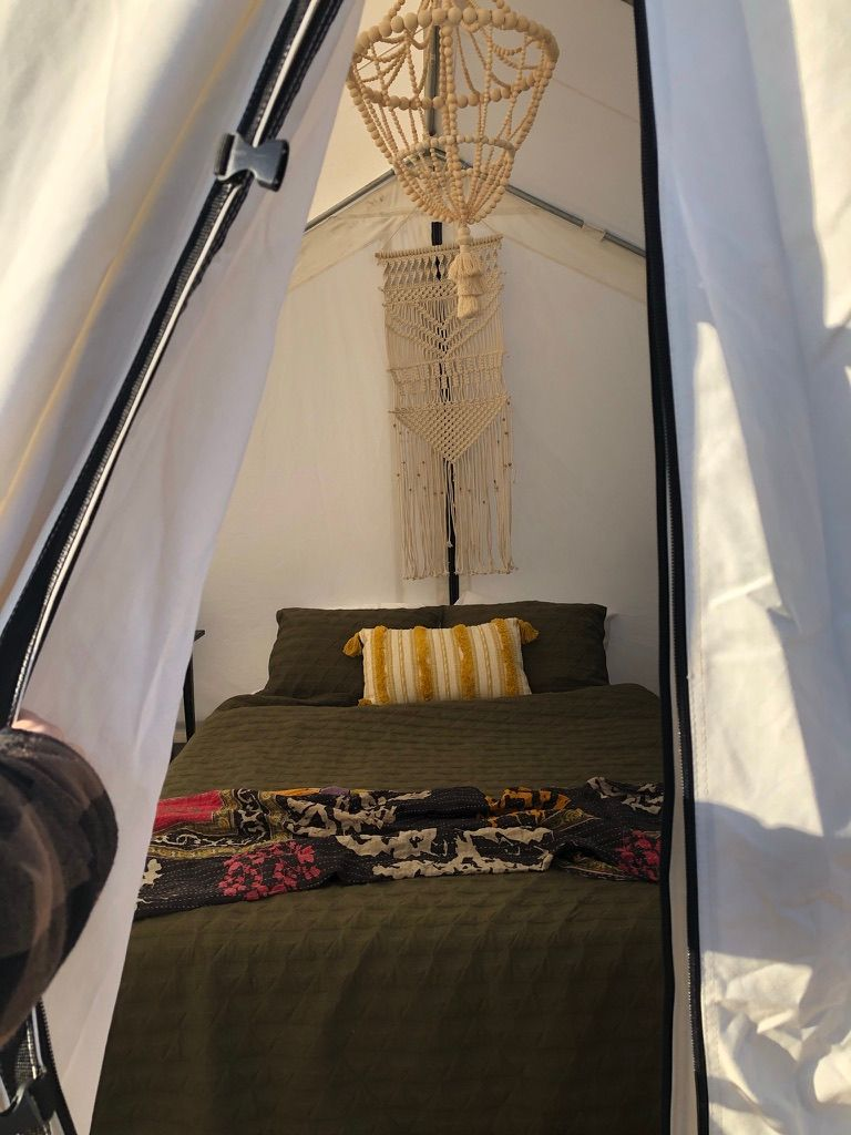queen sized bed at the glamping village in arizona