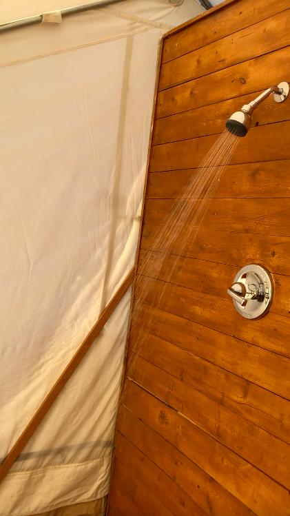 shower inside the bathroom tent